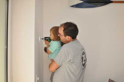Helping Papa take the screws out of the wall